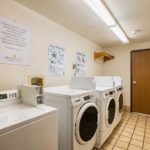 on site laundromat - Siegel Select Albuquerque, NM best priced extended stay hotel suites & weekly / monthly apartment rentals